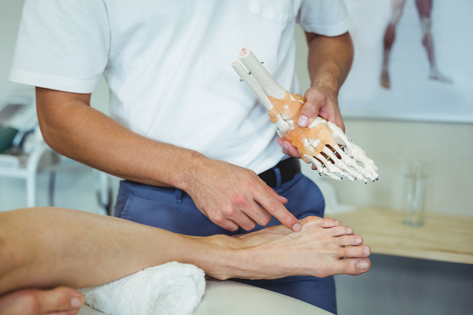 Chiropractor explaining cause of foot pain