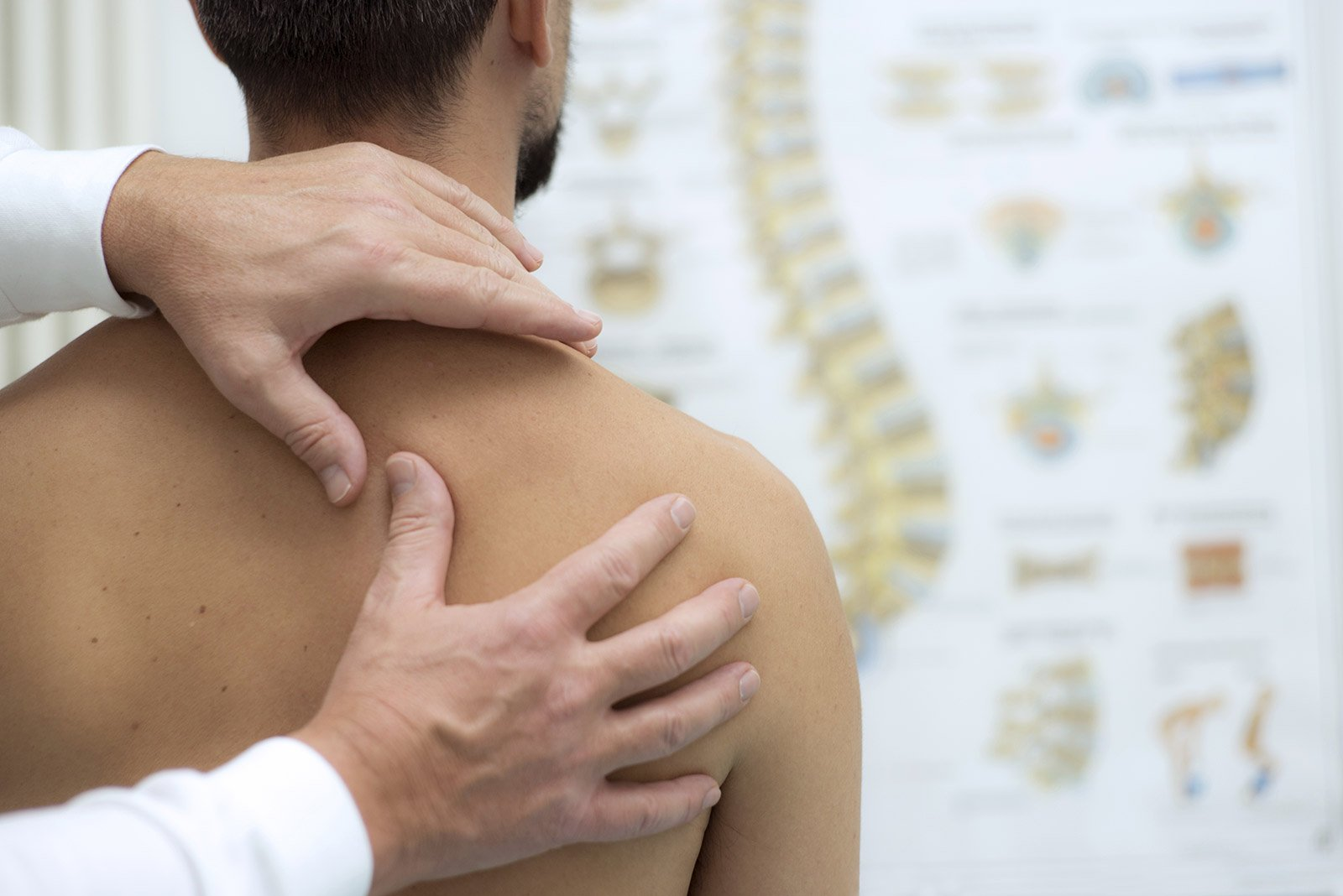 Chiropractor performing assessment for back pain